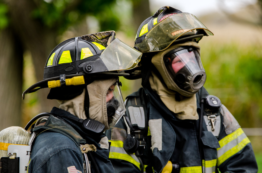 pair of firefighters in full gear